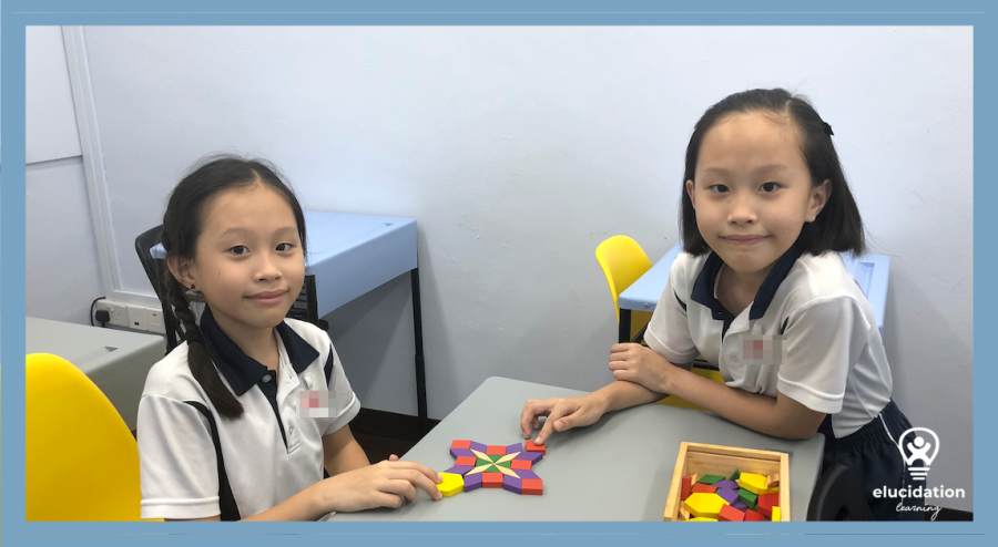 twin girls with geometric puzzle